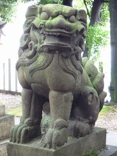Komainu 狛犬  a pair of stone guardian dogs (at the gate of a Shinto shrine)