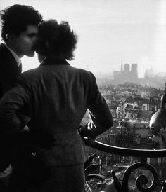 m3zzaluna:  one of the emblematic images by this lover of paris who excelled at capturing fleeting moments brimful of emotion. here the two lovers look from the bastille column over the sweeping panorama of the capital, stretching from the church of saint-paul to notre-dame, the hôtel de ville and, in the distance, the eiffel tower. the lovers of the bastille (detail), 1957 © willy ronis, from paris. portrait of a city.
