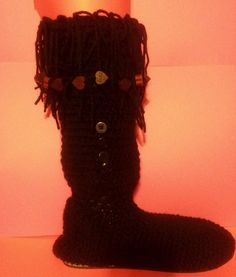 This moccasin boot has a 9 inch top that comes over the calf and just below the knee. Has soles and a draw string to help keep it up on your calf. Sizes up to a 10.5 in men's and women's. Choose one main color, one fringe color and up to two bead colors. Please specify color choices and width (wi...