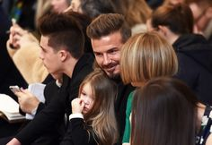 David Beckham brought on adorable family moments at Victoria Beckham's show during New York Fashion Week.
