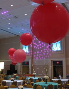 "These over-sized balloons measuring 3′ and 4′ lended an air of sophistication to this nonprofit gala.  They were used in the silent auction (in multiple colors) and in the ballroom (in shades of pink) to beautifully fill the large space.  They created a ""dropped ceiling"" effect.http://www.redappleauctions.com/auction-decoration-ideas-elegant-yes-elegant-balloons/"