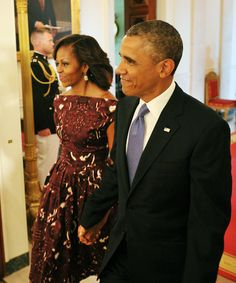 All Smiles: President Barack Obama walked hand in hand through the White House with First Lady Michelle for the National Medal of Arts and National Humanities Medal presentation ceremony.