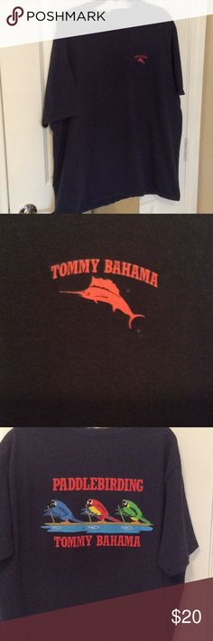 Tommy Bahamas Short Sleeve Cotton T Shirt Navy Worn once, this Tommy Bahama Short Sleeve T Shirt Paddle Birding colorful parrots on it.  The paddle board  has a few blemishes (see photo)  but surely doesn't effect the look of the shirt.  In front of Shirt it has the sword fish and Tommy Bahamas name in red.    Lettering in back is also red.  100% cotton XXL, but when washed, it fits to size XL Tommy Bahama Shirts Tees - Short Sleeve