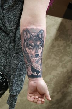 Small wolf tattoo on arm, still beautifull