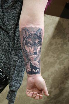 Small wolf tattoo on arm, still beautifull