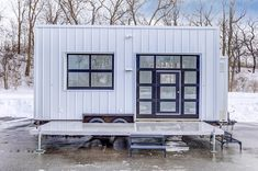 This is the 'Out Cold' tiny house on wheels built by Modern Tiny Living. A truly visionary company wanted a mobile co-work space/coffee bar for their business – and we built them …