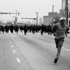 https://flic.kr/p/xmGnzp   Baltimore Riots: The story behind TIME's iconic cover   Devin Allen grew up in west Baltimore surrounded by crime, drugs, and murder. Photography offered him not only a means of rediscovering his community's beauty, but also literally saved his life. Still, he never dreamed that one of his photos would land him on the cover of Time magazine.  Explore the entire story behind this photo on the Flickr Blog.