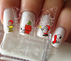 20 water decals on a clear water transfer which can be applied over any color varnish on either your natural or false nail. Use: Paint nails in the color of your choice. Trim transfer to fit you Snoopy Halloween, Snoopy Christmas, Christmas Nail Art, Halloween Nail Designs, Halloween Nail Art, Xmas Nails, Holiday Nails, Cute Nails, Pretty Nails