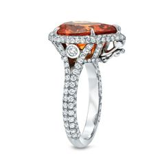 TAMIR Detachable Ring - Pendant Showcasing a Mandarin Garnet and Diamonds. | From a unique collection of vintage cocktail rings at http://www.1stdibs.com/jewelry/rings/cocktail-rings/