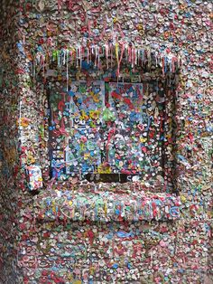 Put a piece of bubble gum on the Market Theater Gum Wall in Seattle