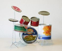 Tin Can Drum Set by Helmut Smits. Year: 2003 Materials: tin cans, metal wire Recycled Art Projects, Recycled Crafts, Art From Recycled Materials, Cd Crafts, Recycling Projects, Recycled Clothing, Recycled Fashion, Craft Projects, Homemade Drum