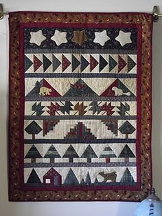 Cabin in the Woods, a row quilt by Cathy A. Buel