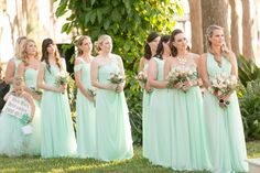 Bridesmaids wearing teal dresses  | Amy and Mikes Lakeside wedding | www.AmalieOrrangePhotography.com