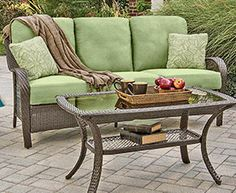 Outdoor comfort in delicious colors, such as avocado (shown) and berry! The Orleans 2-Piece Patio Set includes a plush cushioned sofa and a glass-top coffee table, with bodies made of handwoven resin wicker over steel. Cushions also available in navy and tan. Online only. #shopko