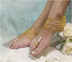 Tap into your inner goddess wearing our trendy barefoot sandals in gold. A spirited multi chain and pearl handmade Boho barefoot sandal, perfect for beach weddings . What makes these fun barefoot sand Beach Wedding Sandals, Beach Wedding Jewelry, Wedding Shoes, Beach Weddings, Isadora Duncan, Anklet Jewelry, Anklets, Jewellery, Boho Chic
