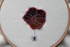 Beautiful little spider is busy weaving away to fix a hole in the fabric that he lives on! Hand embroidery on to wool woven fabric, with cotton threads. Fixed to a embroidery hoop, ready to hang on your wall. Russian Embroidery, Modern Embroidery, Embroidery Hoop Art, Cross Stitch Embroidery, Embroidery Designs, Textiles Techniques, Thread Painting, Textile Artists, Fabric Art