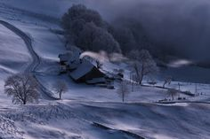 """The old and cosy farmhouse """"Kluserguet"""" in the deep-frozen landscape of the mountain Passwang in Switzerland. Fotorschaffer."""