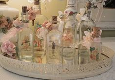 Good post from The Polka Dot Closet: Altered Bottles and Mirror trays