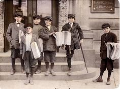 NEWSIES: Colorized photograph of a crew. Notice the one legged boy with a crutch. Large cities had several dailies, sold in the morning and evening. It was the only means for people to get the news beyond their neighborhood or workplace. c. 1900