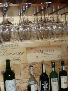 Wine bar back wall done with assorted wooden wine crate panels