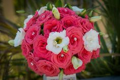 Rose accented with pearls and crystals and a few blooms of lisianthus #beachweddings #floridabeachweddings #simpleweddingsflorida