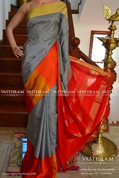 Kanchi soft silk saree with black and white checks body and orange stripes border , pallu with zari woven stripes , this saree has an plain orange blouse and tissue woven top border  Code: J0617SS151205 Cost: 9800 INR Watsapp: 7975097066