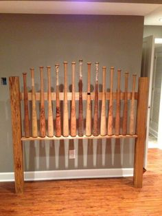 Handmade baseball bat headboard for sports boys room