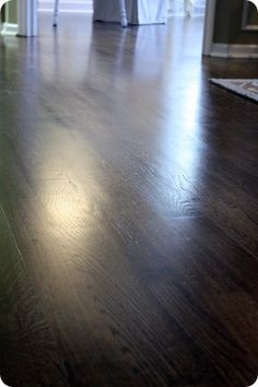 Jacobean stain with satin polyurethane for a dark wood finish instead of black paint to get a great look with less haste Floor Stain Colors, Hardwood Floor Colors, Dark Hardwood, Dark Wood Floors, Paint Colors, Jacobean Stain, Thrifty Decor Chick, Sweet Home, Dark Interiors