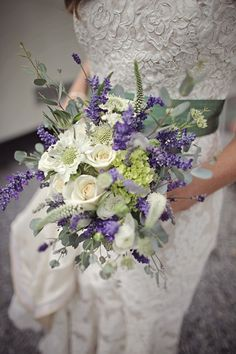 In love with the purple, sage and creams of this bouquet. Beautifully ties in with the sage sash of the dress.