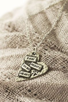 Punk rock style overflowing with sweet sentiment, our pewter heart necklace combines the look of hammered metal with a paw print and the message of Paw prints on my heart.
