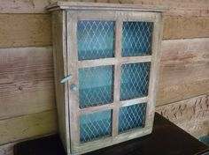 Wood Cabinet With Chicken Wire - I have a cabinet with a broken window.I'm going to use this idea! Refurbished Furniture, Pallet Furniture, Rustic Furniture, Painted Furniture, Painted Shed, Painted Doors, Chicken Wire Crafts, Pallet Barn, Barn Wood Crafts