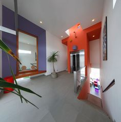 Resort Residence For Home Indoor Stair Area Inviting Acent Orange Also Purple To Match Among White Oceanic Residence Designed with Colorful Neon Colors