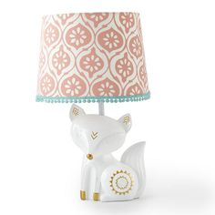 Babies R Us Exclusive! The Fiona Lamp Base and Shade features a lovely white fox lamp base with metallic gold accents. The matching lamp shade is a coral print fabric with teal trim. This lamp will brighten up the room while adding a decorative accent to your nursery.<br><br>The Levtex Baby Fiona Lamp Base and Shade Features:<br><ul><li>Features a lovely white fox lamp base with metallic gold accents.</li><br><li>The matching lamp shade is a coral print fabric with teal…