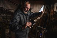 Blacksmith working at his workshop
