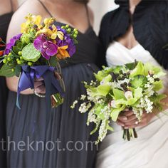 Natural-colored mix of hydrangeas layered with cymbidium orchids, berries, succulents and fiddlehead ferns, her bridesmaids held celosia, orchids, spider mums and lotus pods.