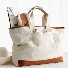 Canvas with Leather - Canvas with Leather Tote / Mark and Graham Carry OnZipper closure w/ one zippered inside pocket and two open pockets for phone & keys.{Monogram lovers fave} Canvas with Leather Tote for the perfect summer travel.You acquired to Burberry Handbags, Tote Handbags, Clutch Bags, Burberry Bags, Bowling Bags, Fabric Bags, Shopper, Handmade Bags, Handmade Leather