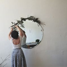 Big round unframed mirror and garland