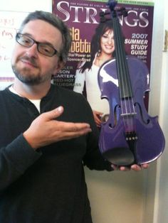 'Strings' Senior Editor Greg Olwell with the office purple fiddle (hand-crafted no less). In solidarity with New Mexico middle school student Camille Cruz who was told last week that her purple violin was not suitable for the orchestra class and the sixth-grader would have to rent one of the district's violins that is a more traditional color: http://www.daily-times.com/ci_21500517/purple-violin-causes-controversy-classroom#