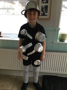 Our very own saucepan man costume! Plastic pots wrapped in foil. Cardboard handles, foil wrapped. Glued on to old tshirt and shorts with glue gun.