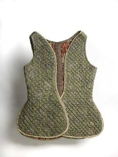 Underbodice Quilted brocaded damask bodice lined with coarse cotton, printed in madder. The outer silk is a dark green damask, brocaded with a sprig in silver thread (file and frise), this silk probably dates from the 1690s but the quilting obscures the pattern. The lining is a very coarse woven cotton printed in three shades of madder with a formal lattice pattern with pencilled blue details.