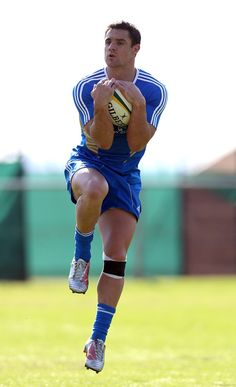 Dan Carter catches the ball during the New Zealand All Blacks training session held at Wits University on October 4, 2012 in Johannesburg, South Africa.