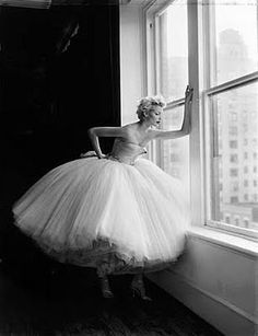 Patrick Demarchelier. This pose is very narrative. Bridal or wedding pose.
