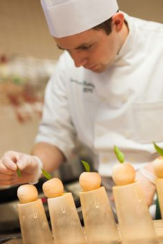 CIA Student preparing Meat Fruits for the Grand Opening of The Bocuse Restaurant