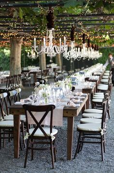 Chandeliers and hanging lights turn this reception space into an enchanted garden.