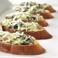 Spinach parmesan crostini.. super easy and delicious for an appetizer or side dish