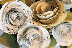 LOVE this idea!  Sheet music flowers!   http://inspiredbyfamilymag.com/2012/03/19/rolled-paper-flowers/