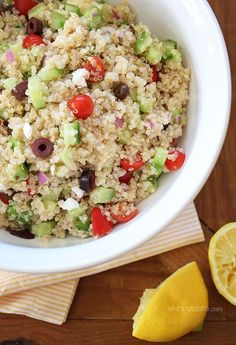 Mediterranean Quinoa Salad – A protein packed salad with Mediterranean flavors – quinoa, cucumbers, tomatoes, kalamata olives, red onion, extra virgin olive oil, fresh lemon and a little feta cheese combined makes a healthy salad with fresh clean ingredients.