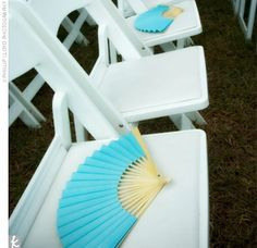 keep guests cooled off in the summer sun with fans! you can even personalize them! (buy on theknot.com or other wedding websites)