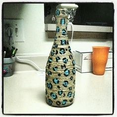 Wine bottle wrapped in twine with leopard print pattern painted on it.. it took maybe 30 mins to do the whole thing and I love how it turned out!!