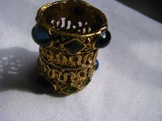 Hey, I found this really awesome Etsy listing at https://www.etsy.com/listing/129131154/filigree-bronzy-patina-lipstick-holder